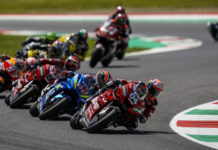 Andrea Dovizioso (04) leading Alex Rins (42), Danilo Petrucci (9), Marc Marquez (93), and the rest of the field during the 2019 Italian Grand Prix at Mugello. Photo courtesy of Dorna/www.motogp.com.