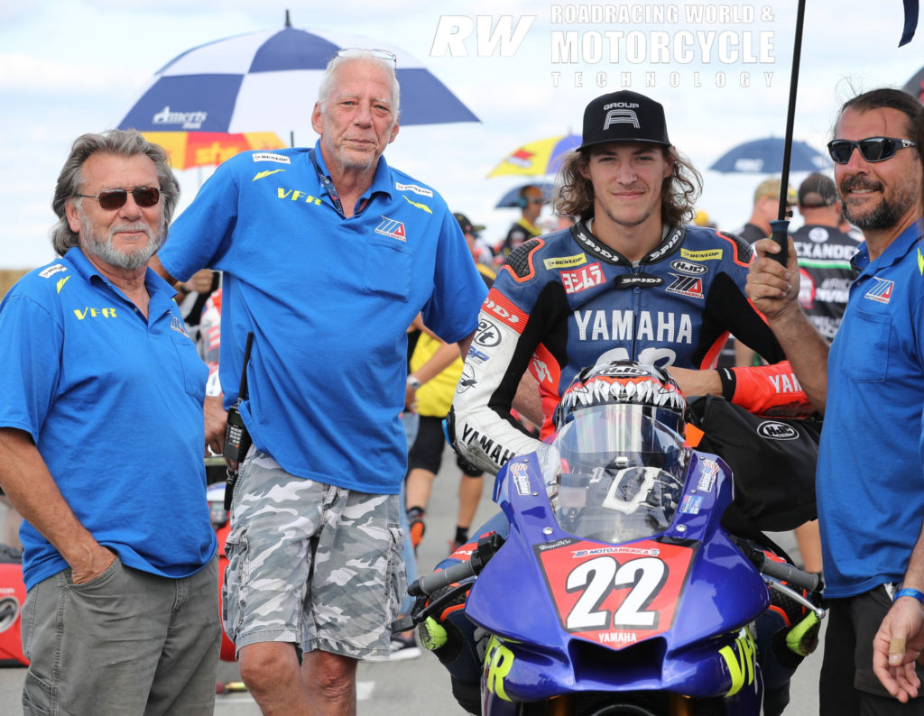 Ashton Yates (second from right) on the MotoAmerica Stock 1000 grid with grandfather Lucky Yates (far left), father Aaron Yates (far right), and VFR owner Vic Fasola (second from left) at Pittsburgh International Race Complex in 2019. Photo by Brian J. Nelson.