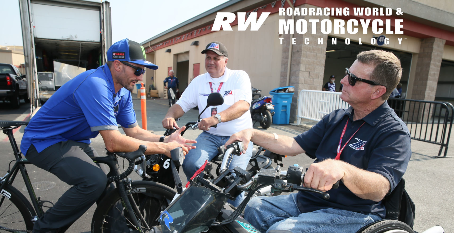MotoAmerica President Wayne Rainey (right), MotoAmerica Chief Operating Officer Chuck Aksland (center), and four-time AMA Superbike Champion Josh Hayes (left) during a MotoAmerica event at Sonoma Raceway in 2018. Photo by Brian J. Nelson.