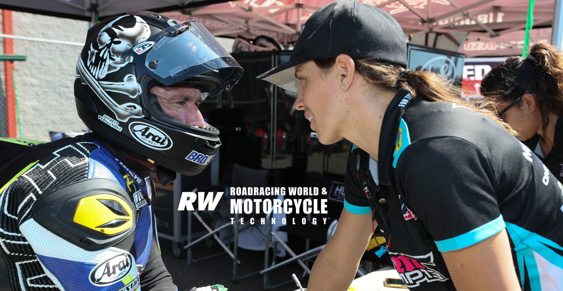 Josh Hayes (left) with his wife, MP13 Racing team owner and MotoAmerica racer Melissa Paris, at New Jersey Motorsports Park in 2019. Photo by Brian J. Nelson.