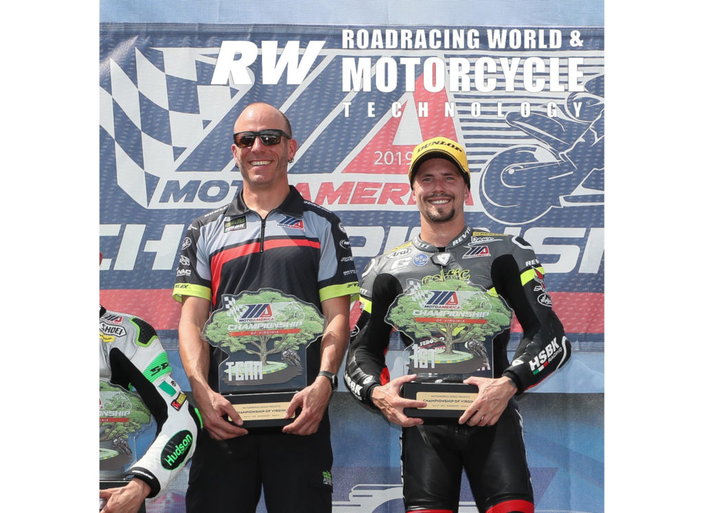 PJ Jacobsen (right) with his crew chief, former AMA Superbike racer Scotty Jensen (left) on top of the MotoAmerica Supersport podium after winning at VIR in 2019. Photo by Brian J. Nelson.