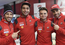 Andrea Saveri (second from right) with Andrea Dovizioso (far left), Danilo Petrucci (second from left), and Michele Pirro (far right). Photo courtesy of Ducati Corse.