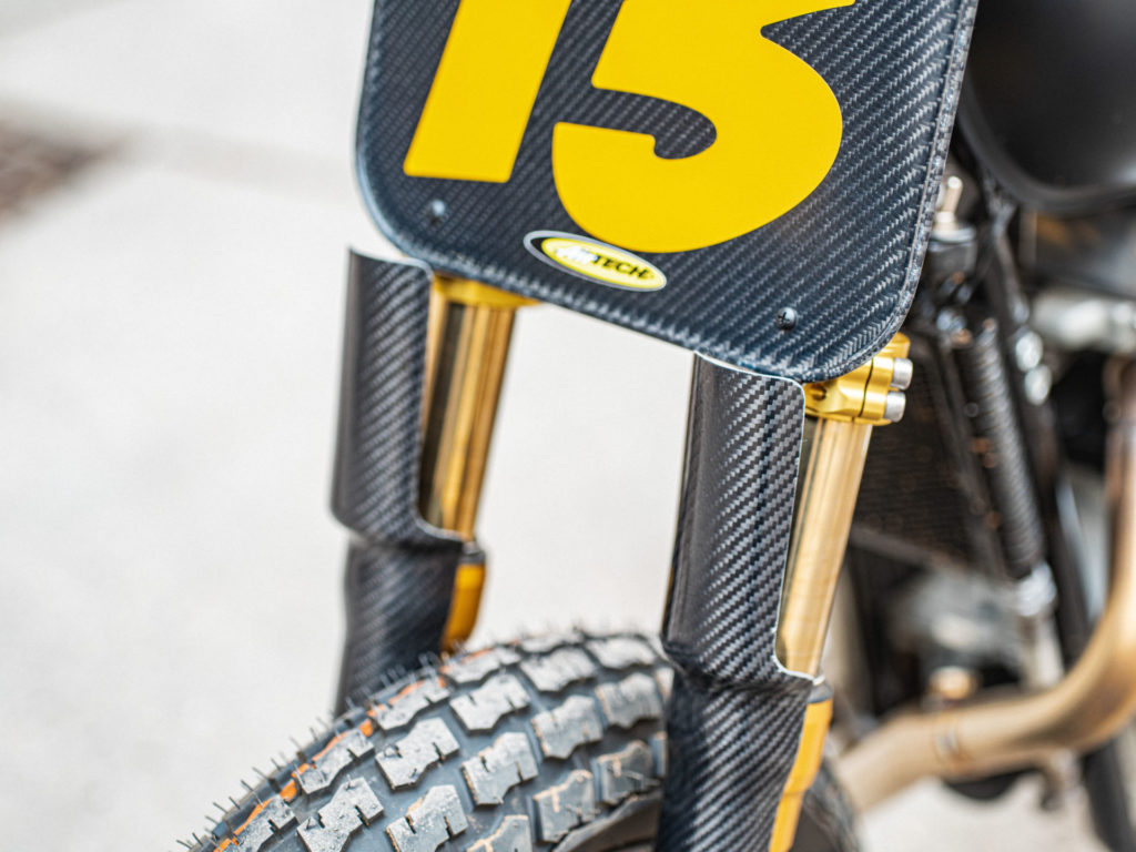 The carbon-fiber number plate and fork guards on Melissa Paris' one-off Royal Enfield INT 650 flat tracker. Photo by Brandon LaJoir, courtesy of Royal Enfield North America.