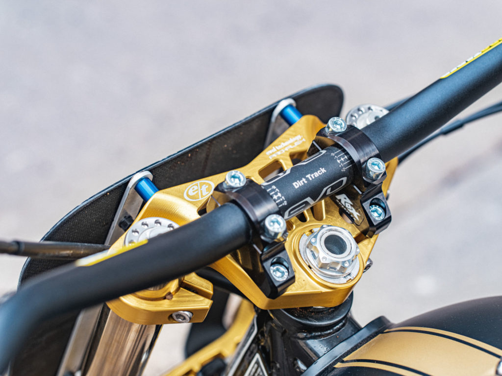 The addition of Ohlins forks necessitated the use of custom triple clamps from Evol Technology on Melissa Paris' one-off Royal Enfield INT 650 flat tracker. Photo by Brandon LaJoir, courtesy of Royal Enfield North America.