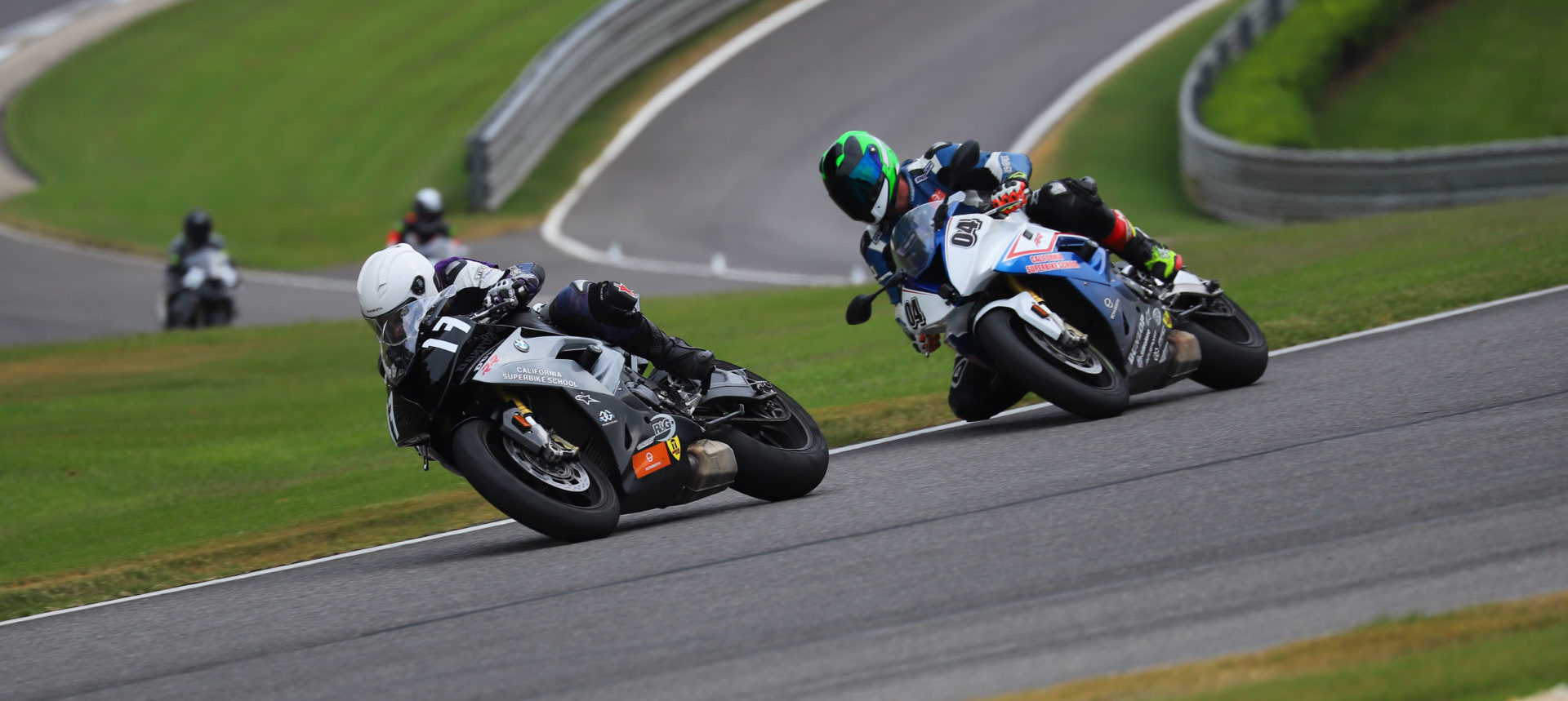 A California Superbike School student (17) and instructor (04) in action at Barber Motorsports Park Photo by etechphoto.com.
