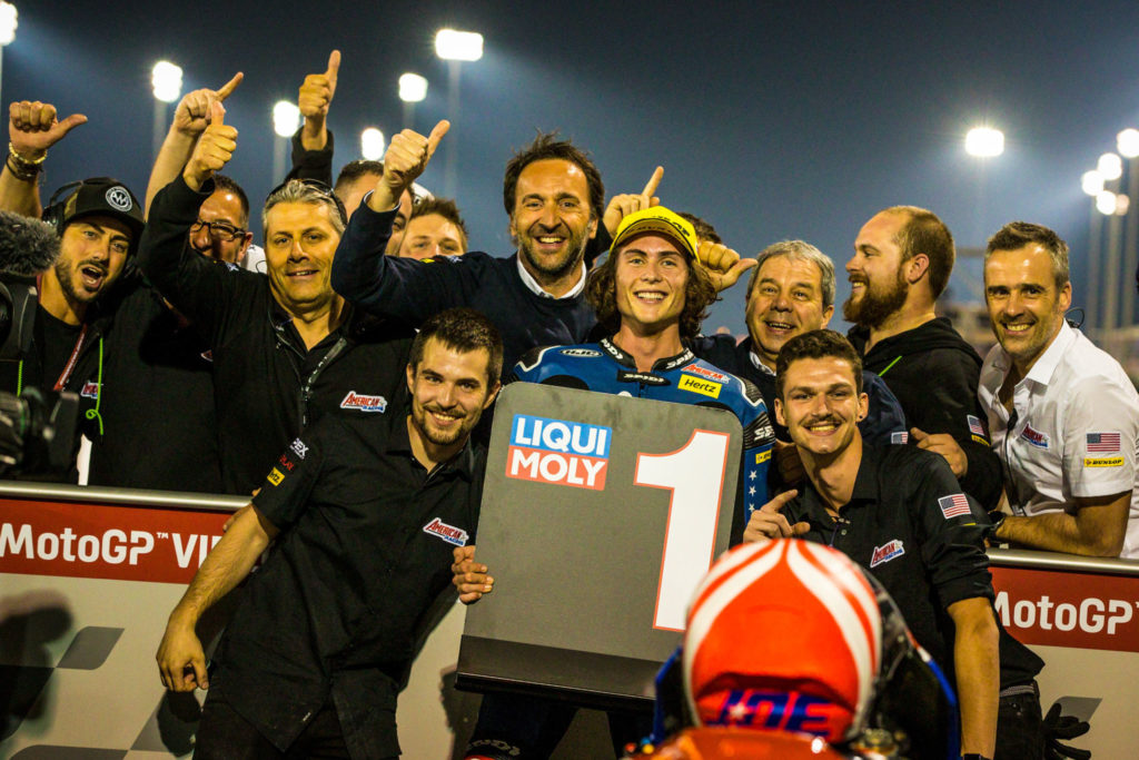 Joe Roberts celebrating his Moto2 pole position in parc ferme with his team in Qatar. Photo courtesy of American Racing Team.
