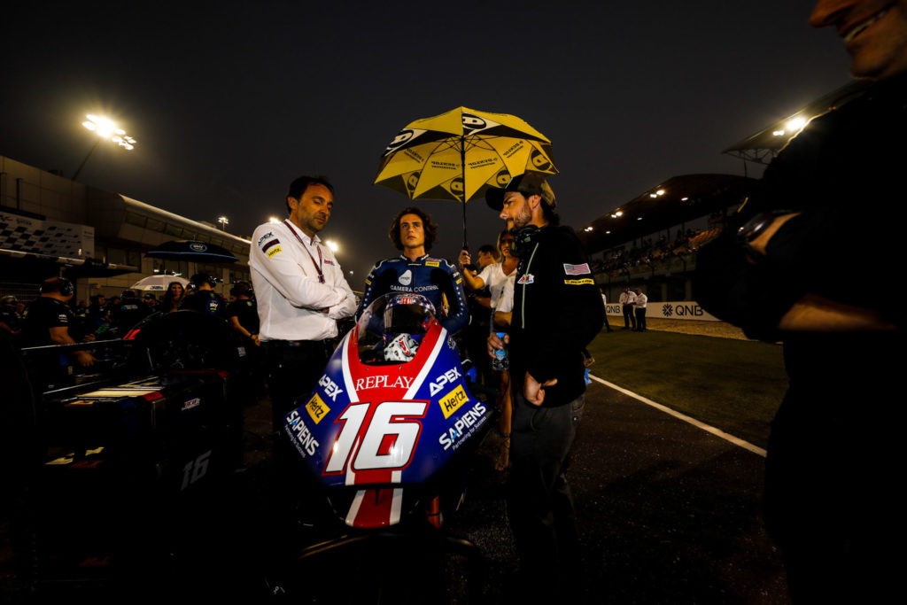 Joe Roberts on the Moto2 grid at Losail International Circuit with his new crew chief Lucio Nicastro (left) and John Hopkins (right). Photo courtesy of American Racing Team.