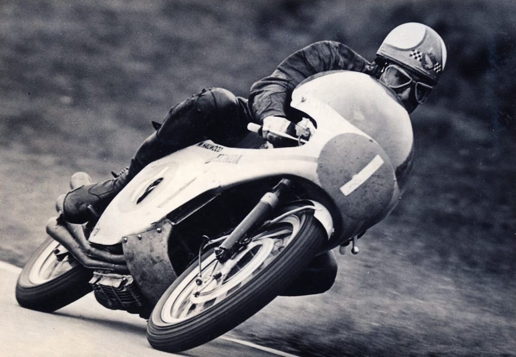 Mike Hailwood (1) at speed on his Honda RC166 , a 250cc six-cylinder machine, in 1967. Photo courtesy Honda Pro Racing.