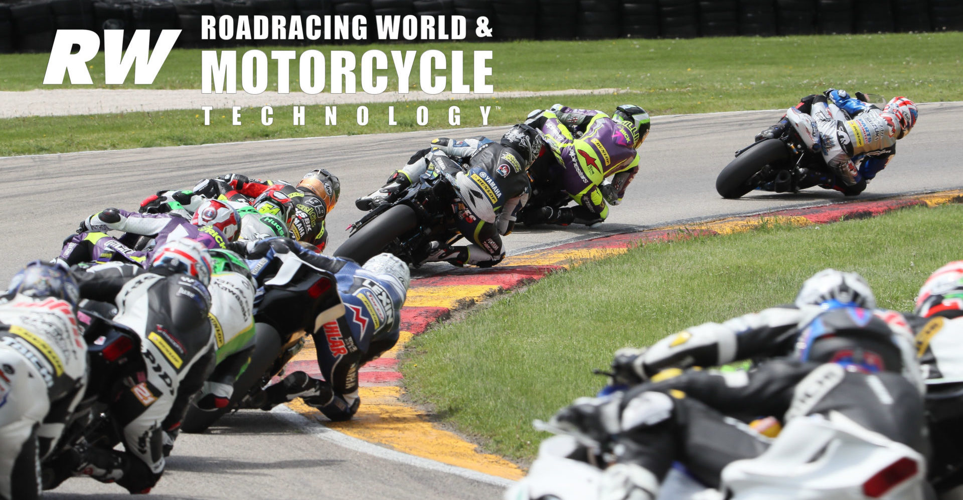 With race leader Bobby Fong already out of frame to the right, Sean Dylan Kelly heads Hayden Gillim, Josh Hayes, PJ Jacobsen, Richie Escalante, and the rest of the field during MotoAmerica Supersport Race Two at Road America in 2019. Photo by Brian J. Nelson.