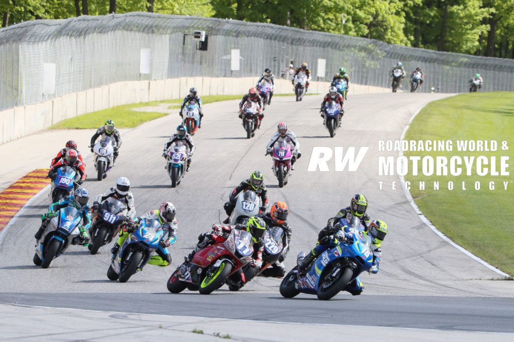 MotoAmerica Twins Cup racers fight for positions on the brakes into Road America's Turn Five in 2019. Here, Alex Dumas (16) leads Draik Beauchamp (77), Darren James (229), Joseph Blasius (24), Kris Turner (38), Chris Parrish (1), Jeff Tigert (911), Cooper McDonald (120), and the rest of the field. Photo by Brian J. Nelson.