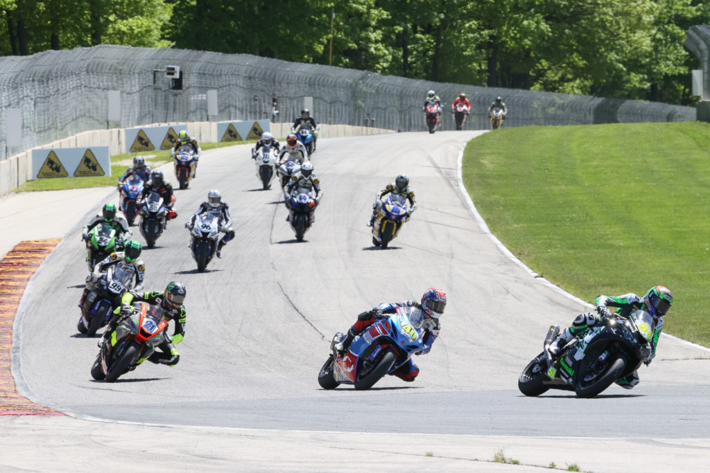 Richie Escalante (54) leads Sean Dylan Kelly (40), Brandon Paasch (21), and the rest of the field during MotoAmerica Supersport Race Two at Road America. Photo by Brian J. Nelson, courtesy MotoAmerica.