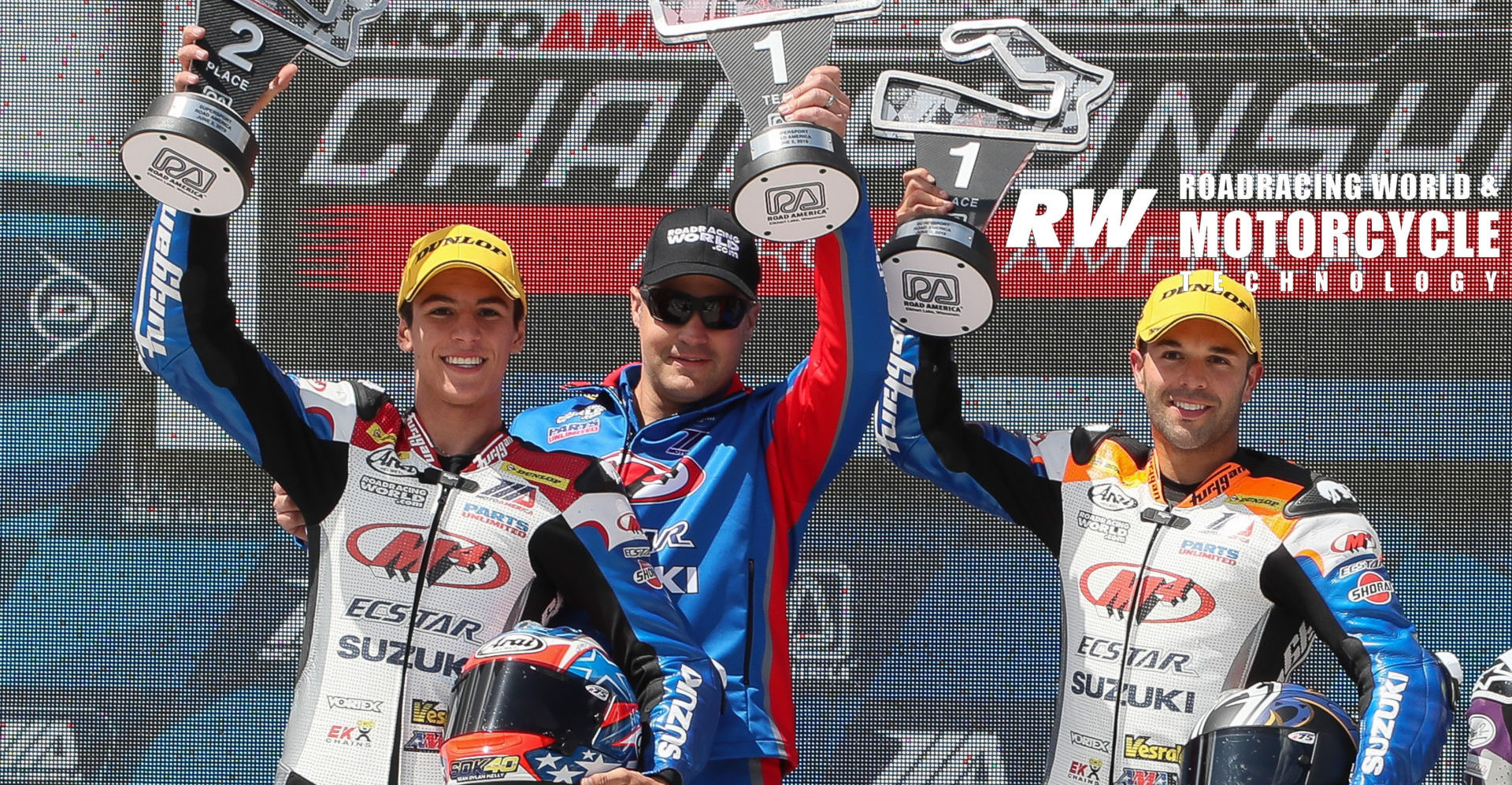 Chris Ulrich (center) on the podium with his riders Bobby Fong (right) and Sean Dylan Kelly (left), after Fong won and Kelly finished second in MotoAmerica Supersport Race Two at Road America in 2019. Photo by Brian J. Nelson.