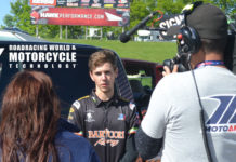 MotoAmerica Junior Cup racer and recent high school graduate Dominic Doyle getting interviewed by a camera crew after breaking the lap record and securing pole position for his races at Road America. Photo by David Swarts.