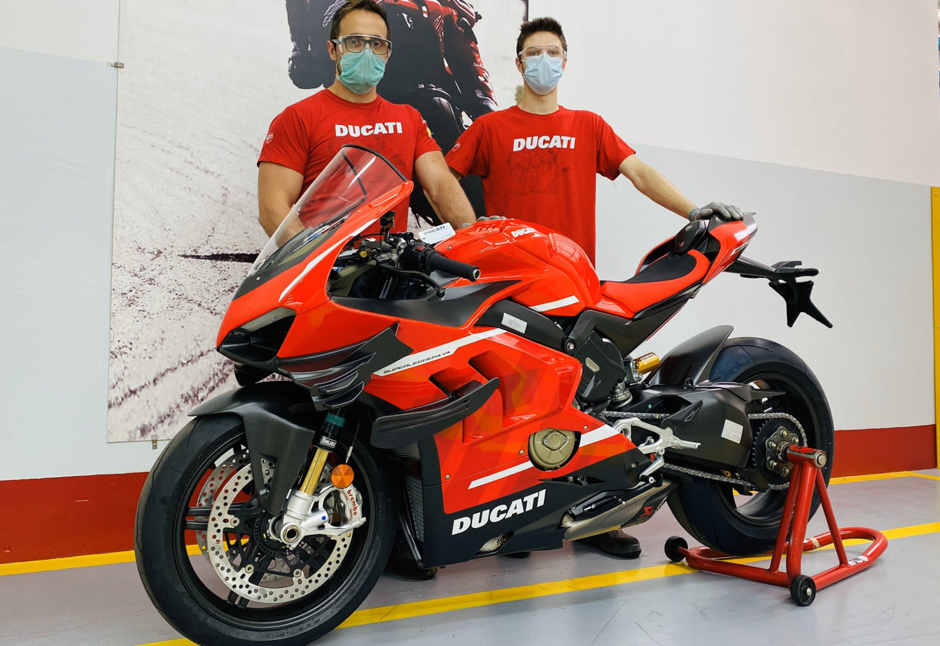Workers with a pre-production Ducati Superleggera V4 at Ducati's factory in Italy. Photo courtesy Ducati.