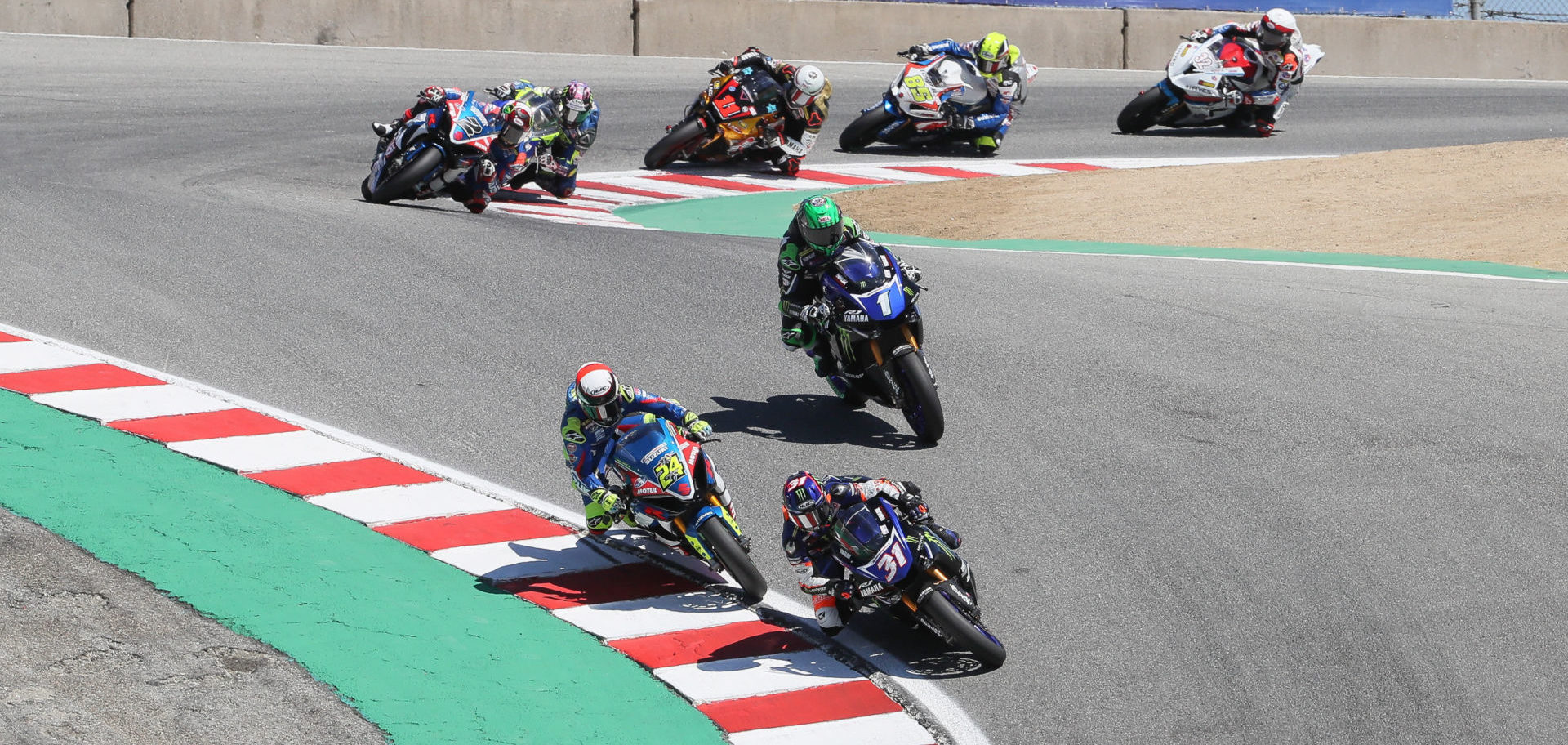 Garrett Gerloff (31) leads Toni Elias (24), Cameron Beaubier (1) and the rest of the MotoAmerica Superbike field at WeatherTech Raceway Laguna Seca in 2019. Photo by Brian J. Nelson.