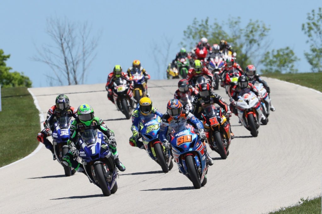 Cameron Beaubier (1) passes Bobby Fong (50) for the lead early in MotoAmerica HONOS Superbike Race Two at Road America. Photo by Brian J. Nelson, courtesy MotoAmerica.