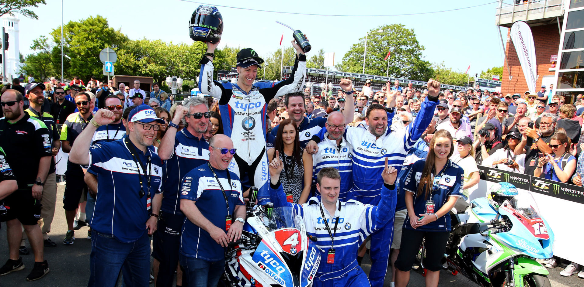 Ian Hutchinson and the TAS Racing team after winning a race at the Isle of Man in 2016. Photo courtesy BMW Motorrad Motorsport.