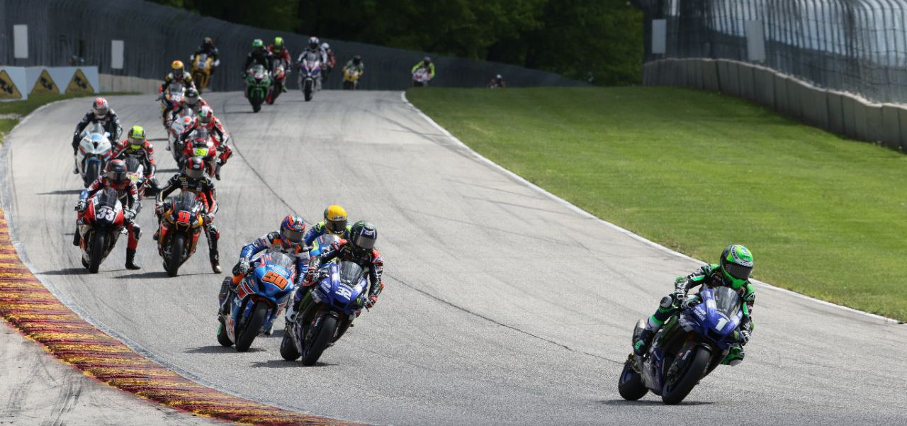 Cameron Beaubier (1) leads Jake Gagne (32), Bobby Fong (50), Toni Elias (behind Gagne), Mathew Scholtz (11), Kyle Wyman (33), and the rest of the MotoAmerica HONOS Superbike field early in Race One at Road America. Photo courtesy of Yamaha.