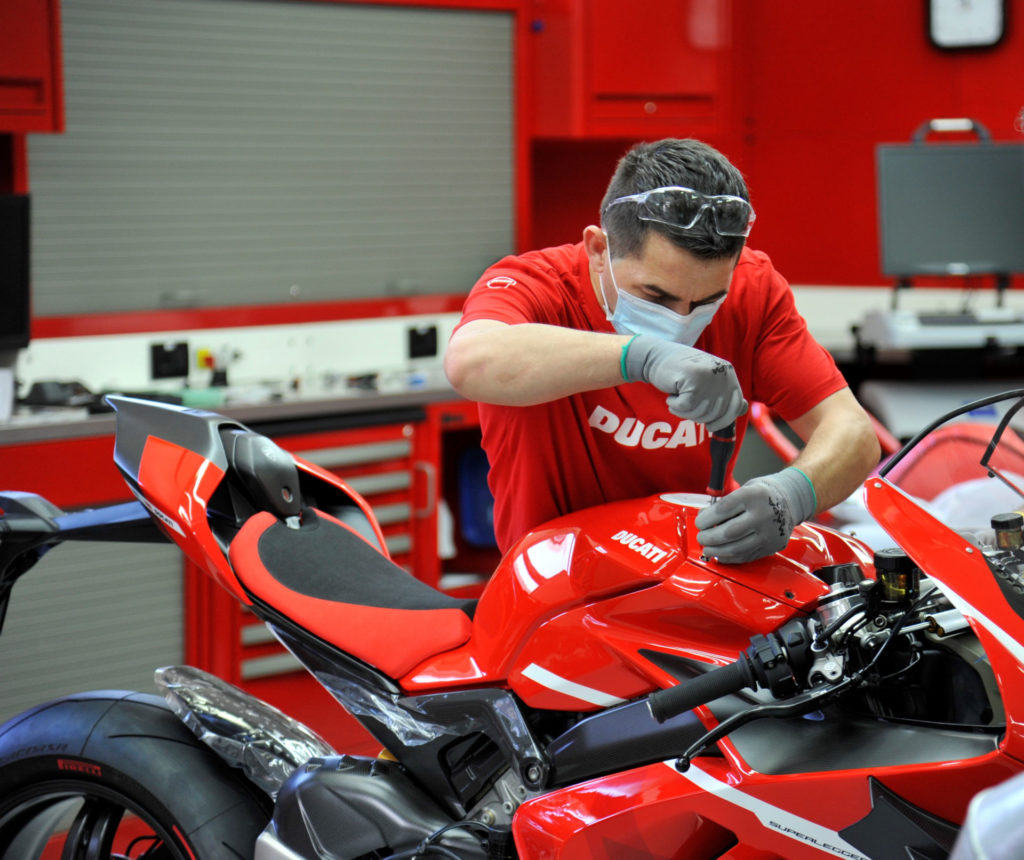 A Ducati worker puts some finishing touches on Ducati Superleggera V4 001 of 500 at the factory in Italy. Photo courtesy Ducati.