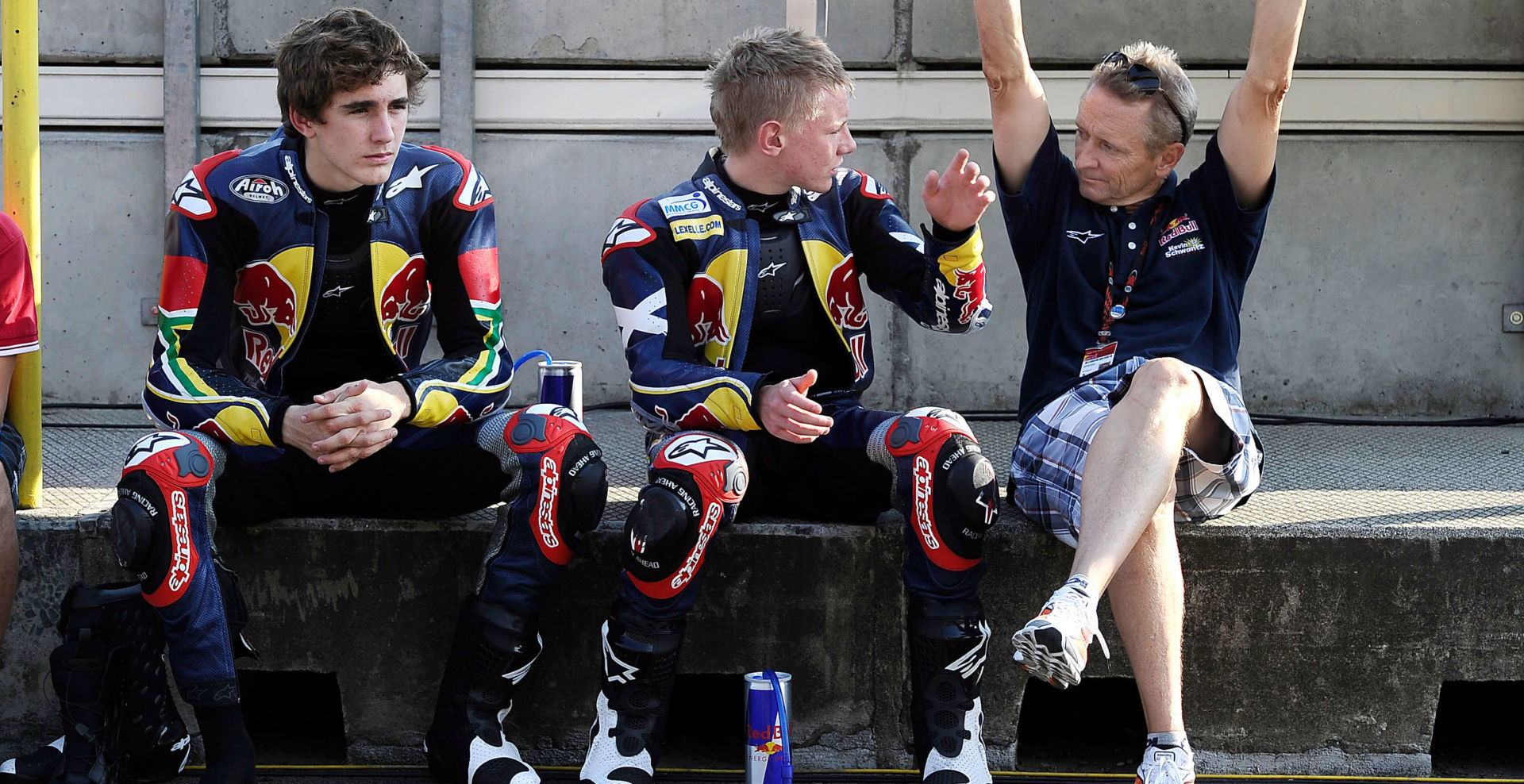 Kevin Schwantz (right) working with Red Bull MotoGP Rookies Cup riders Taylor Mackenzie (center) and Mathew Scholtz (left) at Brno in 2010. Photo by Gold& Goose/GEPA Pictures, courtesy Red Bull.