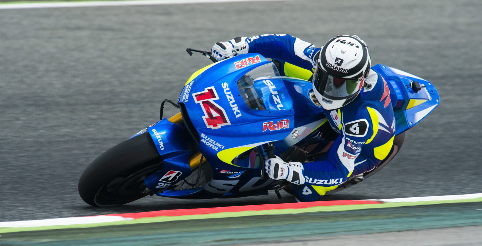 Randy de Puniet (14) in action on the Suzuki GSX-RR MotoGP prototype racebike. Photo courtesy of Team Suzuki Press Office.