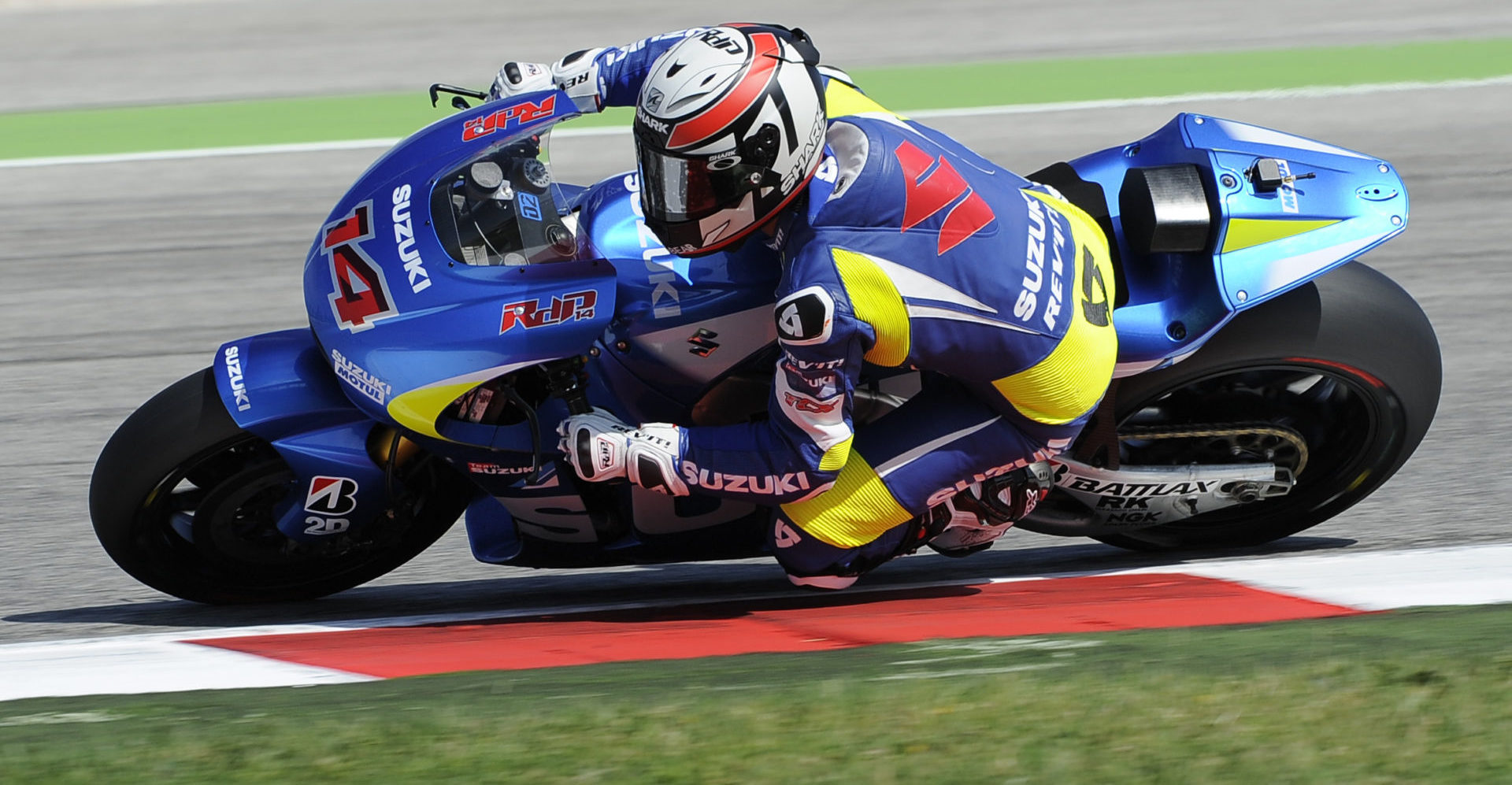 Randy de Puniet (14) testing the Suzuki GSX-RR MotoGP prototype at the Misano Circuit in 2013. Photo courtesy Team Suzuki Press Office.