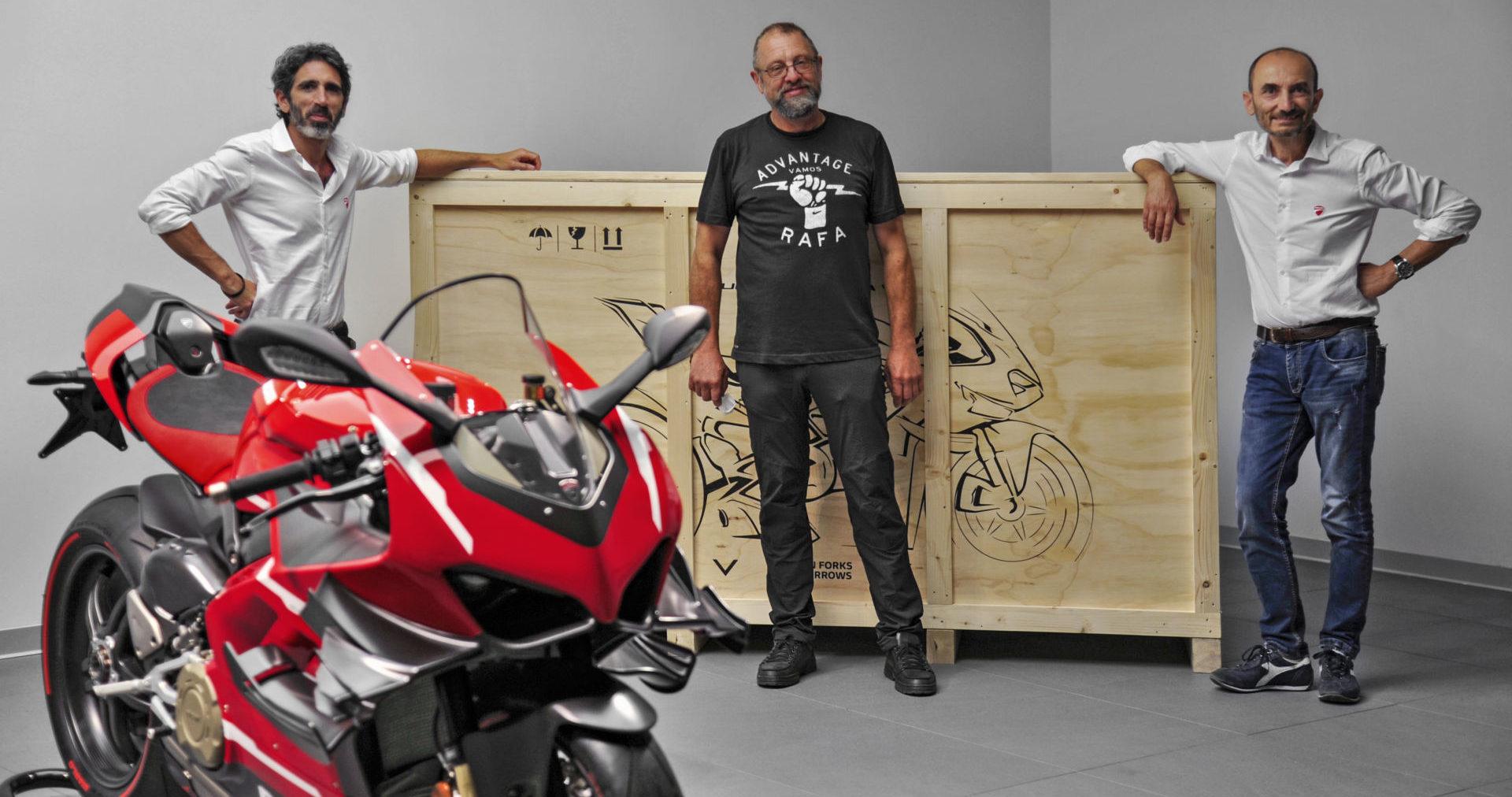 Ducati VP Global Sales and After Sales Francesco Milicia (left) and Ducati CEO Claudio Domenicali (right) deliver Superleggera V4 #001 to Ducatista Filip Van Schil (center) at the Ducati factory in Italy. Photo courtesy Ducati.