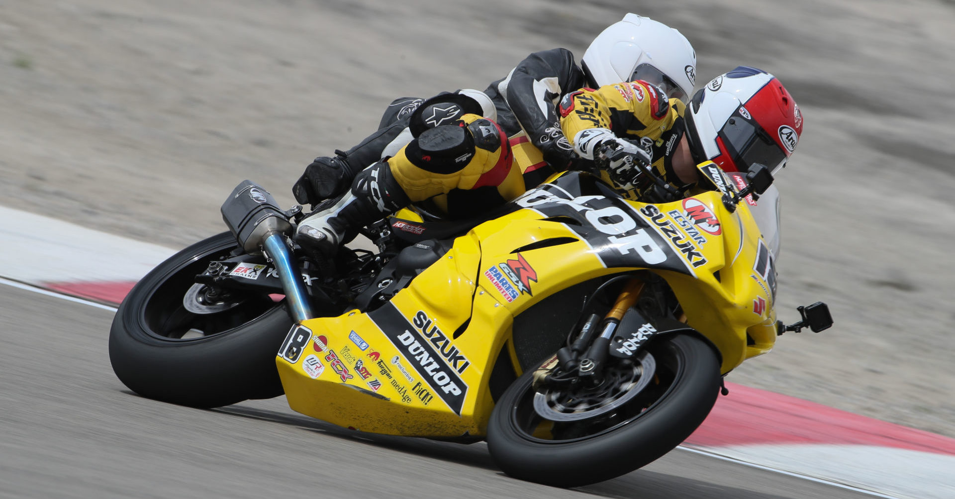 Chris Ulrich pilots the Dunlop M4 Suzuki Two-seat Superbike. Team Hammer has been operating the program for 20 years. Photo by Brian J Nelson.