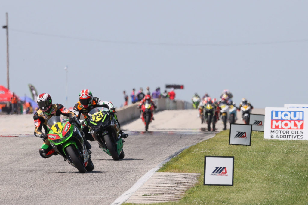 Rocco Landers (1) leads Dominic Doyle (25) and the rest of the field during MotoAmerica Liqui Moly Junior Cup Race 2 at Road America. Photo by Brian J. Nelson, courtesy MotoAmerica.