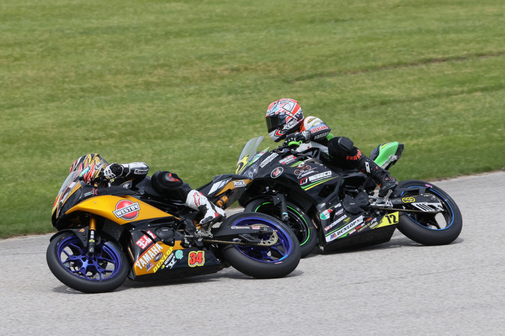 Cody Wyman (34) battles with Benjamin Gloddy (72) during MotoAmerica Junior Cup Race Two at Road America. Photo by Brian J. Nelson, courtesy Westby Racing.