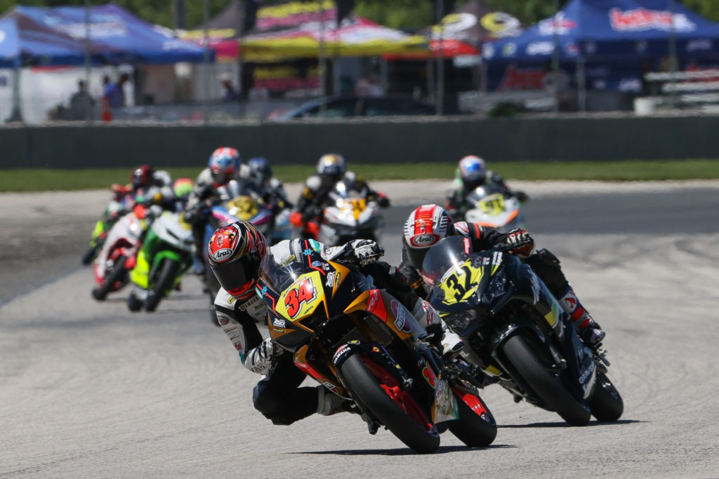 Cody Wyman (34) leads a group of riders during MotoAmerica Junior Cup Race One at Road America 2. Photo by Brian J. Nelson, courtesy Westby Racing.