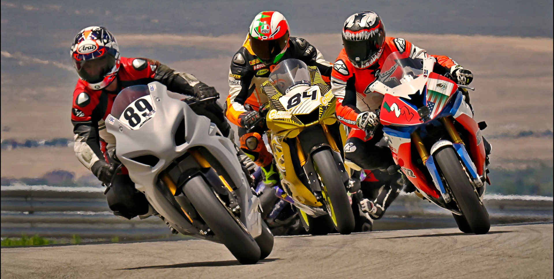 Adam Robarts (89) leads ahead of Kory Cowan (84) and Genaro Lopez (122) on the first lap of the Utah Motorcycle Law Master's of the Mountains Race June 20 at Utah Motorsports Campus. Photo by Steve Midgley, courtesy UtahSBA.