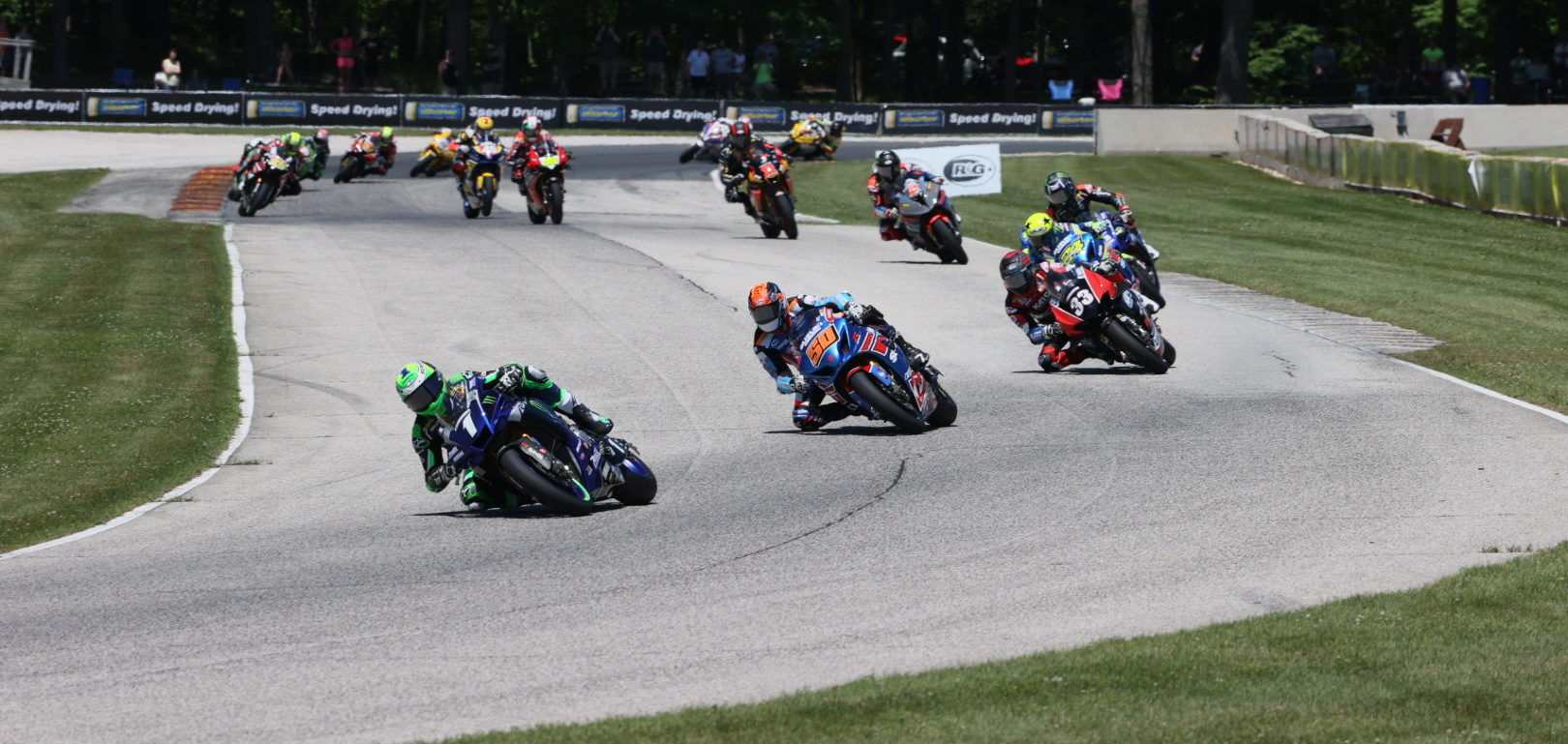 Cameron Beaubier (1) leads Bobby Fong (50), Kyle Wyman (33), Toni Elias (24), Jake Gagne (32), Josh Herrin (2), Mathew Scholtz (11), and the rest of the field early in MotoAmerica Superbike One. Photo by Brian J. Nelson, courtesy MotoAmerica.