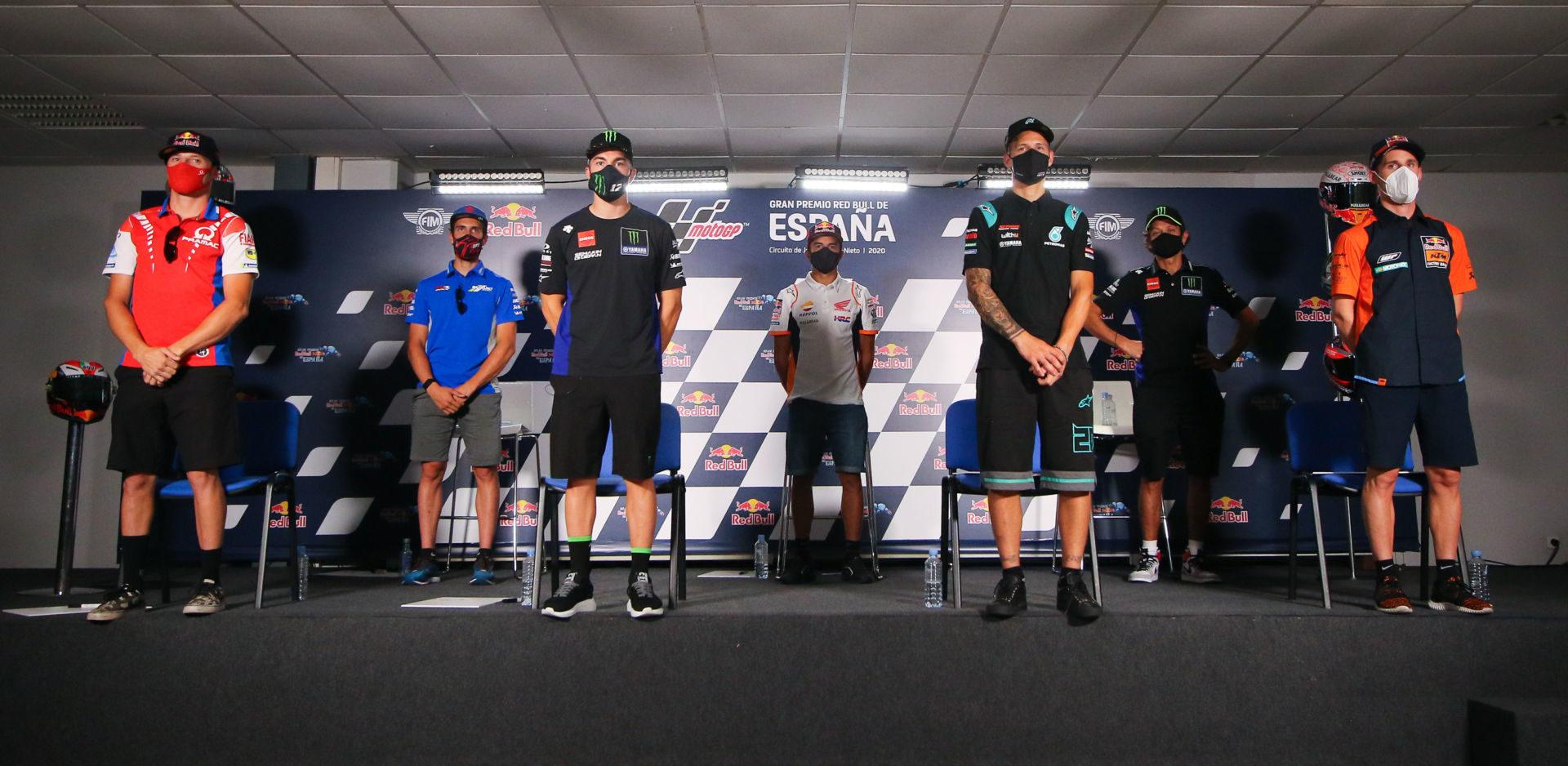 The socially distant MotoGP pre-event press conference at Jerez with (from left) Jack Miller, Alex Rins, Maverick Vinales, Marc Marquez, Fabio Quartararo, Valentino Rossi, and Pol Espargaro. Photo courtesy Dorna.