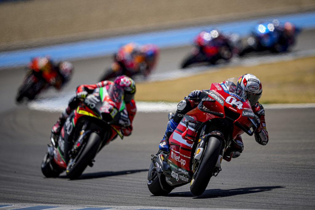 Andrea Dovizioso (04) leading Aleix Espargaro (41). Photo courtesy Ducati.