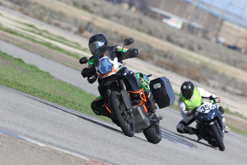 A participant and a control rider at a Let's Ride Track Day event at Buttonwillow Raceway Park. Photo courtesy of Let's Ride Track Days.