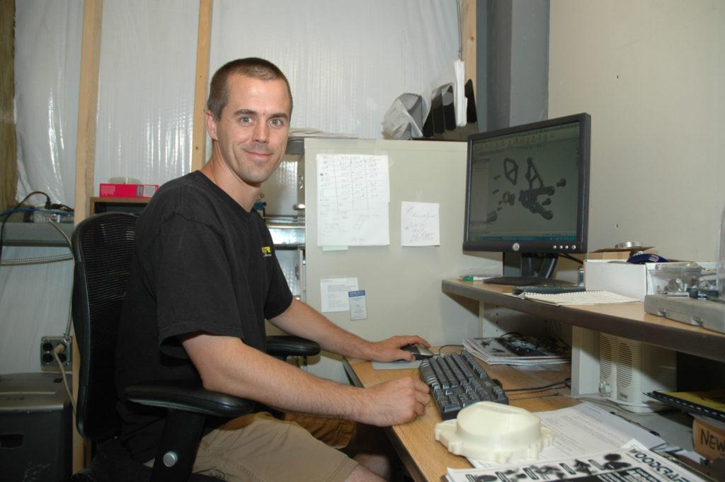 Eric Wood at his desk at Woodcraft, circa 2010. Photo by David Swarts.
