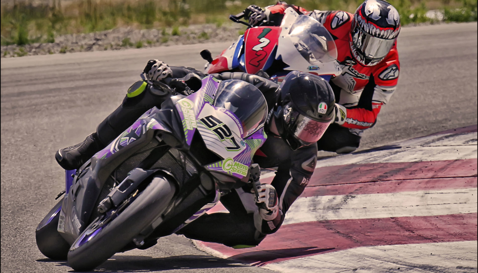 Jerry Hicks (527) fends off Genaro Lopez (122) into Turn 10 at Round 4 of UtahSBA's Utah Motorcycle Law Masters of the Mountains Race Series July 25th at Utah Motorsports Campus. Photo by Steve Midgley, courtesy UtahSBA.