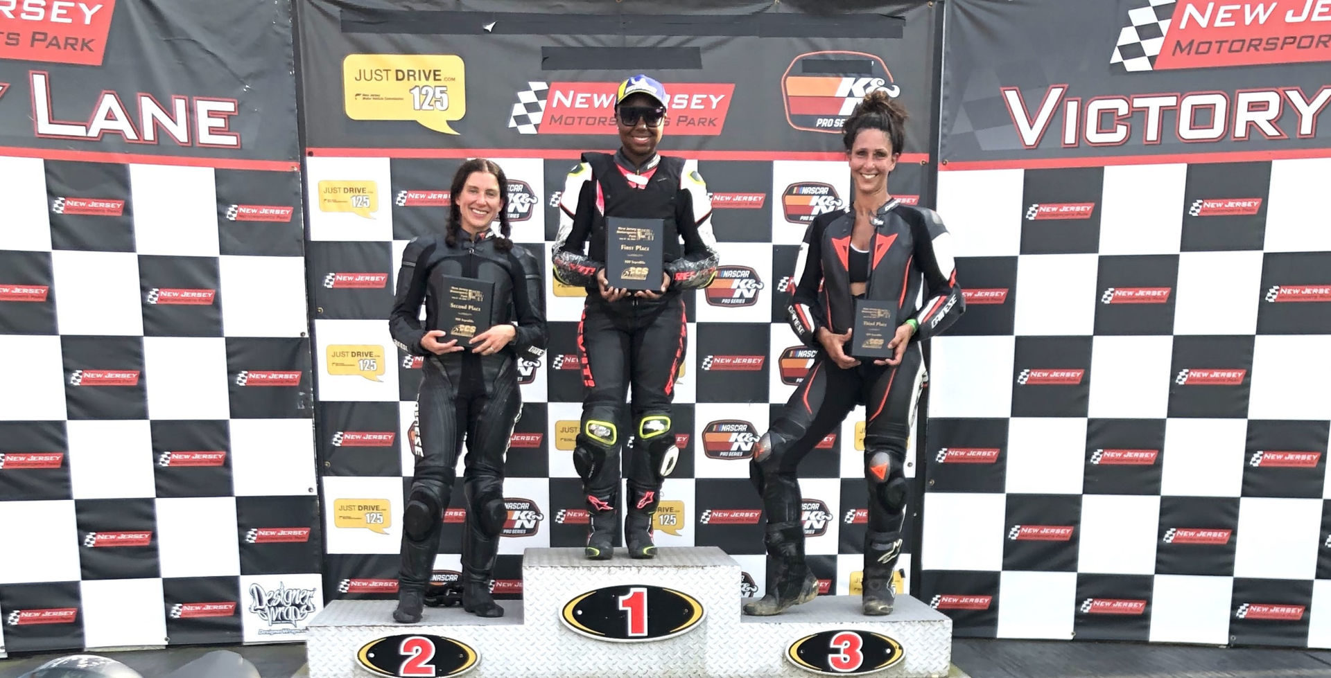 MotoGirlGT 500 Superbike race winner Mikayla Moore (center), runner-up Cassie Cuppek (left), and third-place finisher Michele Beneducci (right). Photo by Angela Izzo-Sink, courtesy MotoGirlGT.