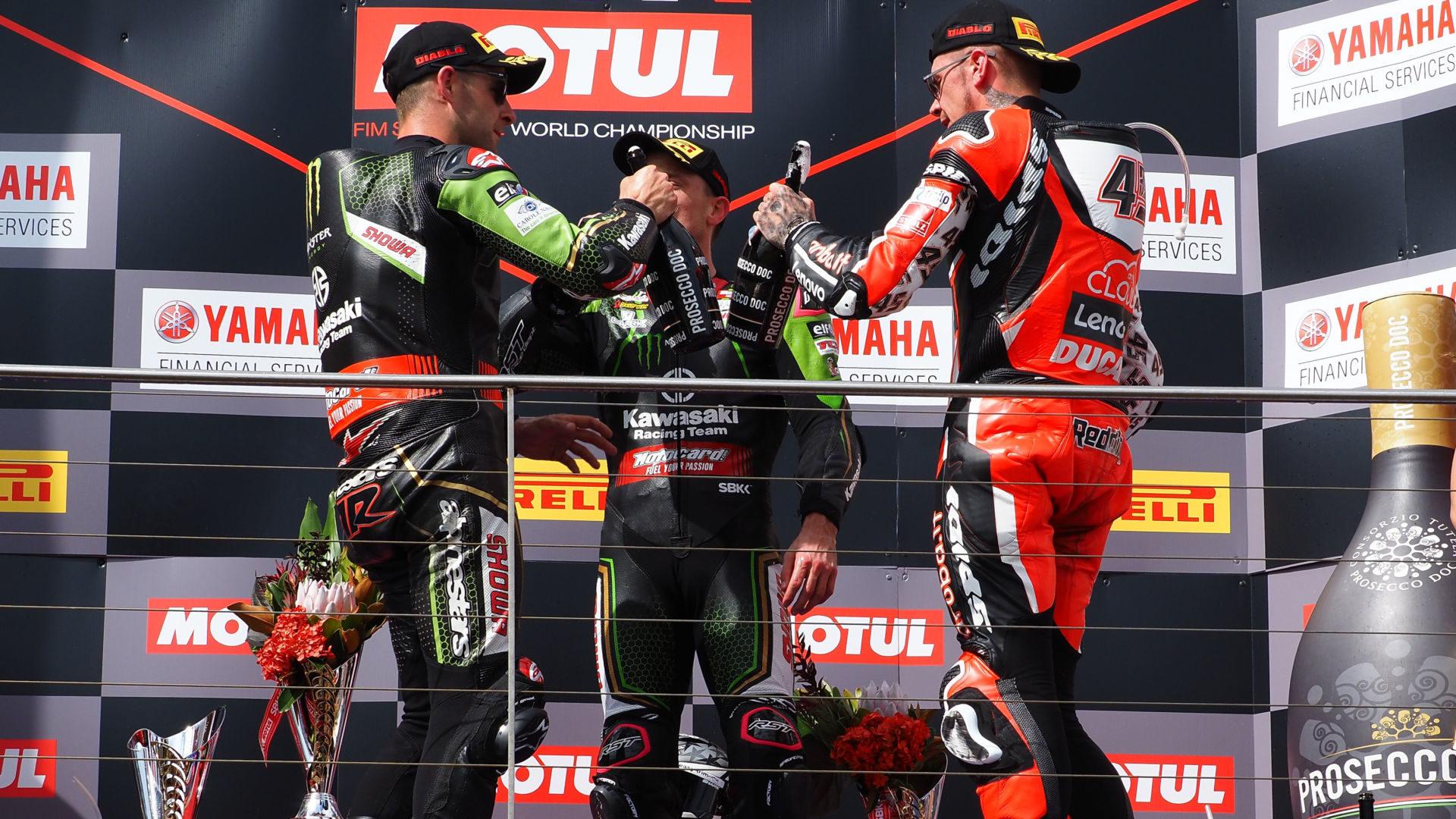 Jonathan Rea (left), Alex Lowes (center) and Scott Redding (right) celebrate with Prosecco champagne on a World Superbike podium. Photo courtesy Dorna.