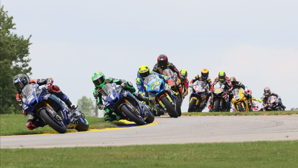 Jake Gagne (32) leads Cameron Beaubier (1), Toni Elias (24), Mathew Scholtz (11) and the rest of the MotoAmerica Superbike field early in Race One at Road Atlanta. Photo by Brian J. Nelson, courtesy MotoAmerica.