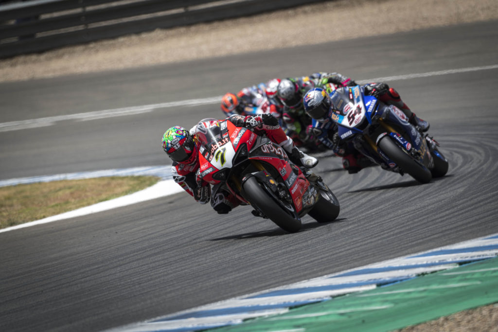 Chaz Davies (7) leading Toprak Razgatlioglu (54) and a group of riders at Jerez. Photo courtesy Ducati.