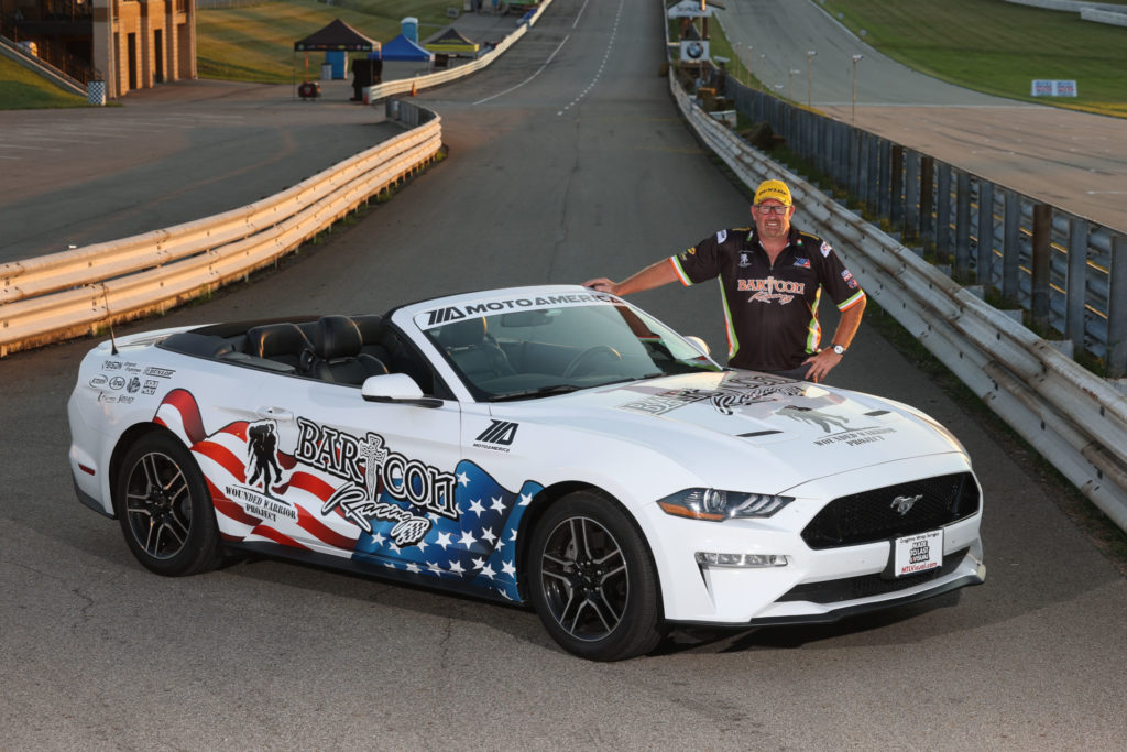 Colin Barton with his Mustang convertible, flying the BARTCON Racing and Wounded Warrior livery. Photo by Brian J. Nelson.