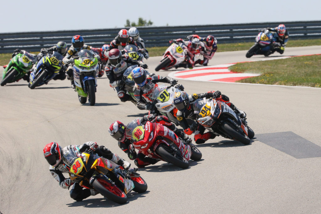 Cody Wyman (34) leading a group of Junior Cup riders at PittRace. Photo by Brian J. Nelson, courtesy Westby Racing.