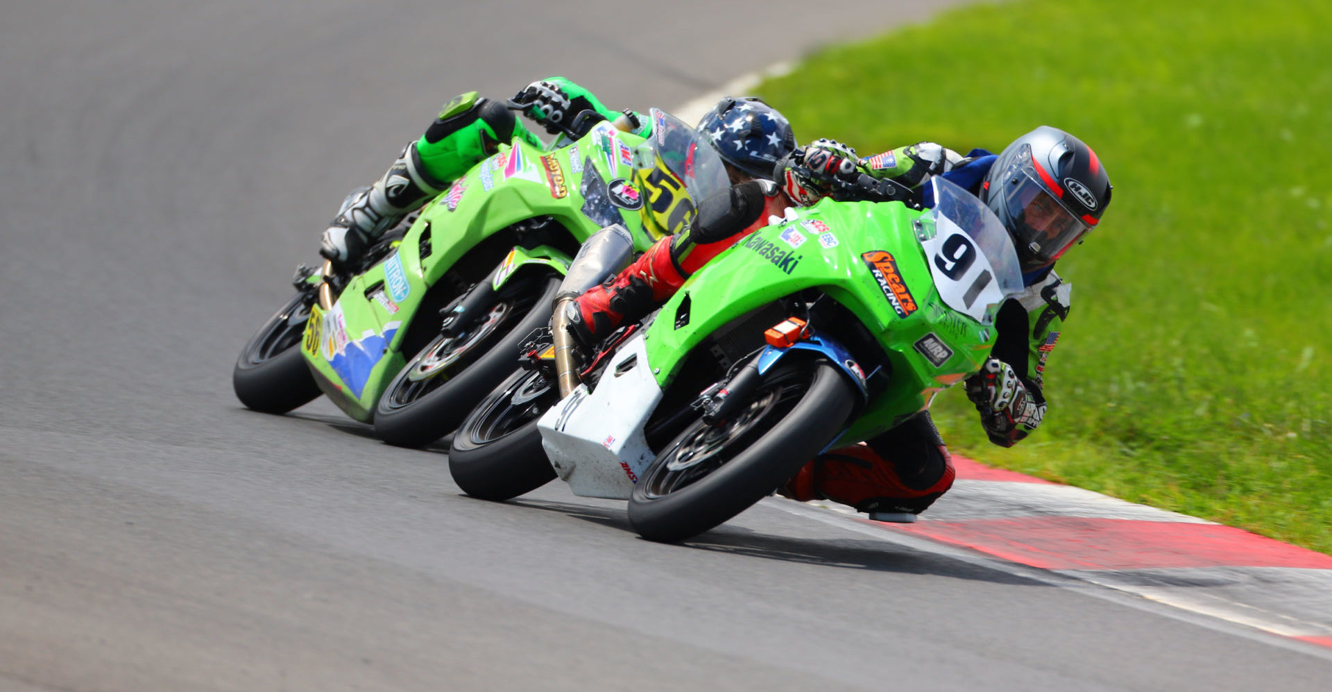 Mark Dickerson (91) and Keegan Brown (56) race for the overall lead in the ASRA Moto 3 Combined race at Summit Point Motorsports Park. Photo by etechphoto.com, courtesy ASRA/CCS.