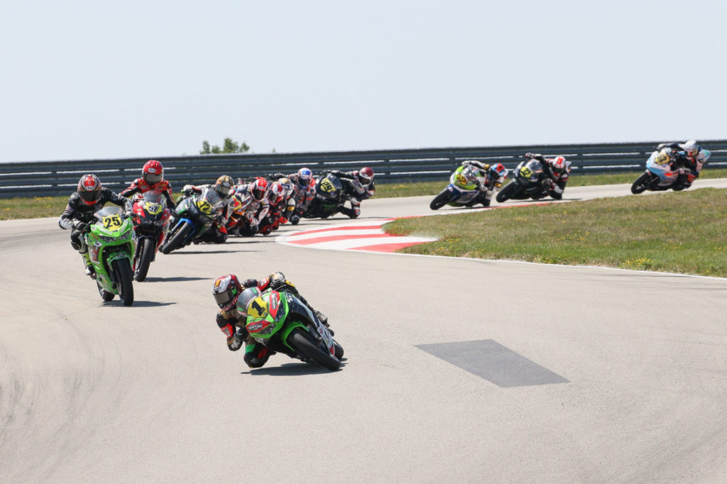 Rocco Landers (1) leads the start of Liqui Moly Junior Cup Race Two at PittRace. Photo by Brian J. Nelson, courtesy MotoAmerica.