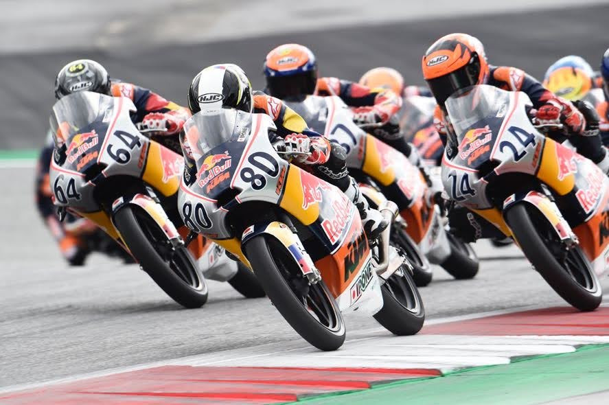 David Muñoz (64), David Alonso (80), and Iván Ortolá (24) during Red Bull MotoGP Rookies Cup Race Two. Photo courtesy Red Bull.