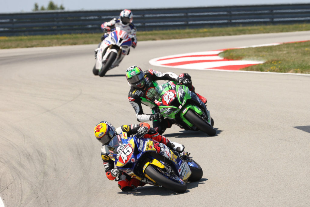 Cameron Petersen (45) leads Corey Alexander (23) and Travis Wyman (10) during Stock 1000 Race Two at PittRace. Photo by Brian J. Nelson, courtesy MotoAmerica.
