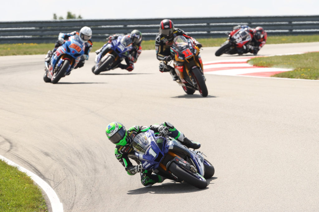 Cameron Beaubier (1) leading Mathew Scholtz (11), Bobby Fong (50), Jake Gagne (32), and Kyle Wyman (33) early in HONOS Superbike Race One. Photo by Brian J. Nelson, courtesy MotoAmerica.