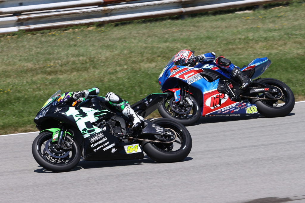 Richie Esclanate (54) and Sean Dylan Kelly (40) battle for the lead in Supersport Race Two. Photo by Brian J. Nelson, courtesy MotoAmerica.